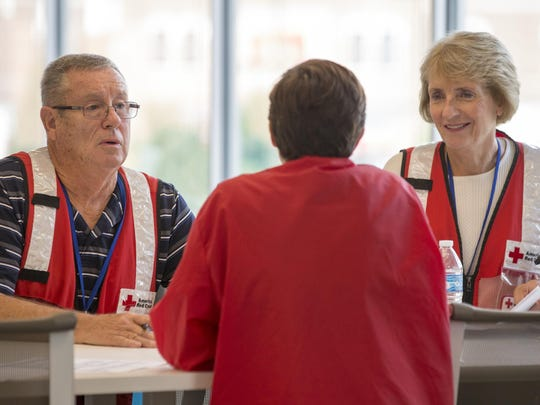 Jesse McDaniel and Deb McDaniel fill out some paperwork at the Red Cross headquarters in Indianapolis, Wed., Aug. 17, 2016. The couple is heading down to Louisiana to help with flood relief.