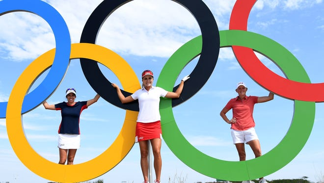 Team USA's Gerina Piller, Lexi Thompson and Stacy Lewis pose with the Olympic rings during a practice round Tuesday.