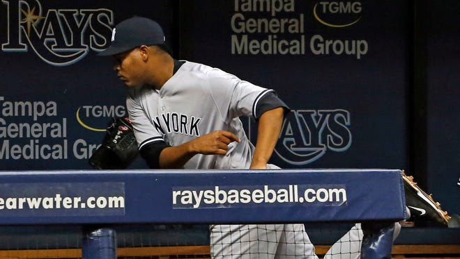 New York Yankees starting pitcher Ivan Nova throws his glove in the dugout after being removed during the fifth inning of a baseball game against the Tampa Bay Rays on Friday, July 29, 2016, in St. Petersburg, Fla.