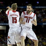 U of L's Luke Hancock, right, and teammate Tim Henderson celebrate one of Hancock's late 3-pointers during a 2013 Final Four game against Wichita State.