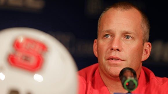 North Carolina State head coach Dave Doeren answers a question during a news conference at the Atlantic Coast Conference Football kickoff in Greensboro, N.C., Monday, July 21, 2014. (AP Photo/Chuck Burton)