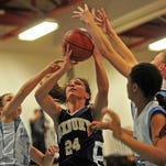 Roxbury's Jamie Katzenberger is surrounded by Parsippany Hills players on a rebound in the first half of a 2013 game.