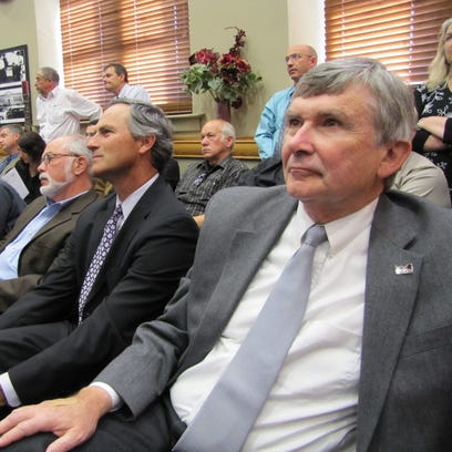 Chamber leader Evan Nolte (right) listens to Mayor Mike Huether as he presents his vision for a new events center at a public information session in 2010.