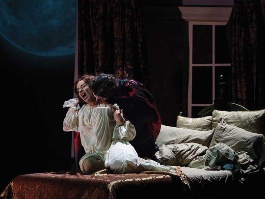 Tyler Pierce, as Dracula, attacks Jamie Ann Romero,