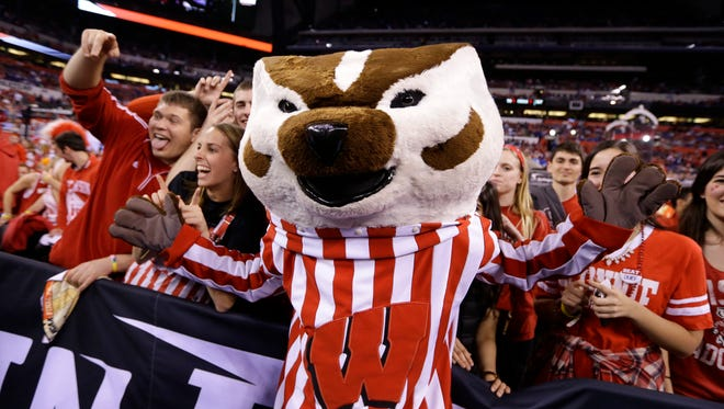 In this April 6, 2015, file photo, the Wisconsin mascot, Bucky the Badger, cheers with fans before the NCAA Final Four college basketball tournament championship game between Wisconsin and Duke in Indianapolis.