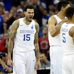Kentucky's Willie Cauley-Stein reacts after Karl-Anthony Towns scores.   March 28, 2015