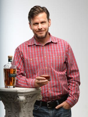 Dan DeHart with his Grander Rum. Unlike many rums, Grander has no additives and gets it's color from being aged in bourbon barrels. DeHart feels it's smoothness makes it a obvious alternative to Scotch and Bourbon for drinking neat or on the rocks. DeHart grew up in Pee Wee Valley and now lives in Florida.