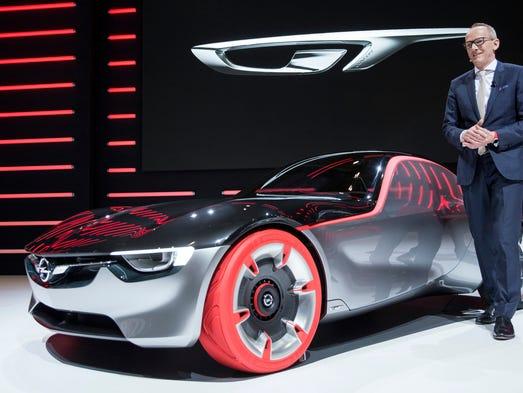 The Opel CEO Karl-Thomas Neumann presents the Opel