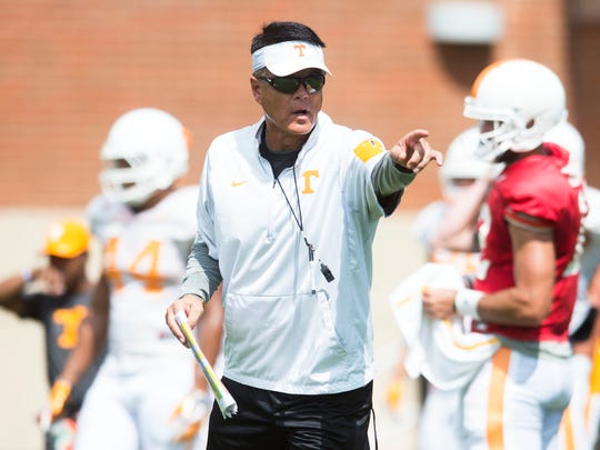 Tennessee Quarterbacks Coach Mike Canales points during a University of Tennessee preseason football practice at Anderson Training Facility in Knoxville, Tenn. on Tuesday, Aug. 15, 2017.
