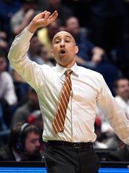 Texas head coach Shaka Smart yells instructions to