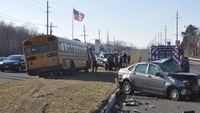 A car collided into two others at a Route 37 intersection Monday. The school bus involved had no children on board.