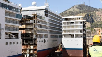 A new, 49-foot-long section is moved into position during a project to lengthen Silversea Cruises' Silver Spirit.