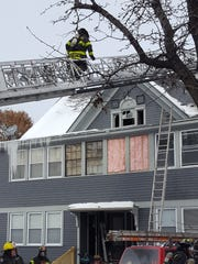 Firefighters on scene of a working multi-family fire