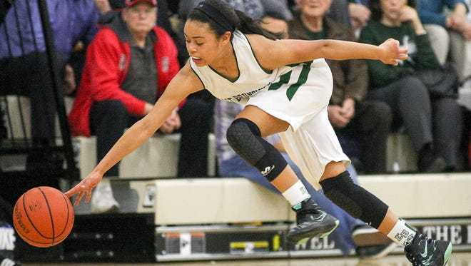 East Brunswicks Nicole Johnson (11) chases a loose ball against Piscataway at East Brunswick girls basketball on February 9, 2016. (Photo by Keith A. Muccilli/ Correspondent)