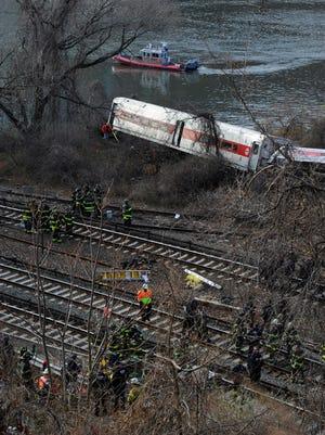 First responders work the scene of the Metro North train derailment near Spuyten Duyvil Station, Bronx, N.Y.