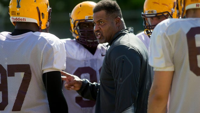 ASU defensive line assistant coach Jackie Shipp talks to his players during football practice at Kajikawa Practice Fields in Tempe on August 8, 2014.