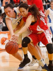 At left, Desert Christian Academy's Jayla Grubbe battles for control of the ball against Hueneme's player during their CIF Championship game at Godinez High School in Santa Ana, California on March 3, 2018.