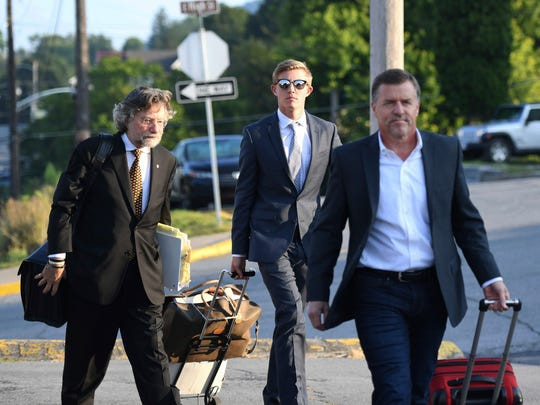 Beta Theta Pi brother Luke Visser, center, arrives for the seventh day of preliminary hearings Thursday, Aug. 31, 2017 at the Centre County Courthouse in Bellefonte Pa. Sinclair said he may decide by the weekend whether prosecutors have presented enough evidence to hold a trial for former members of the now-closed Penn State fraternity charged in connection with a pledge's death.