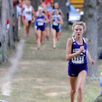 Lexington's Dominique Clairmonte won five state championships in the 2014-2015 school year after missing the entire 2013 cross country season with a stress fracture in her foot.
