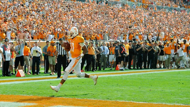 With not a defender around him, Tennessee quarterback Joshua Dobbs (11) runs in for UT's first score of the game in the Outback Bowl on Jan. 1, 2016.