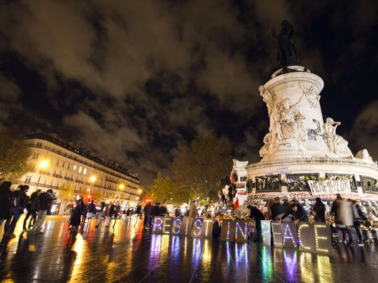 People gather at the Place de la Republique square in Paris  on Nov. 17  to pay tribute to victims of the attacks claimed by Islamic State which killed 130 people and left more than 350.