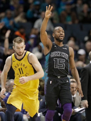 Charlotte Hornets' Kemba Walker (15) celebrates after making a basket against the Indiana Pacers during the second half of an NBA basketball game in Charlotte, N.C., Friday, Feb. 2, 2018.