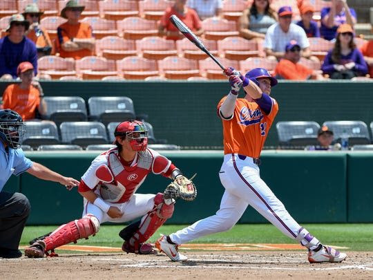 Clemson first baseman Seth Beer (28) hits a home run against St. John's during the top of the fourth inning of the NCAA Clemson Regional at Doug Kingsmore Stadium in Clemson Sunday, June 3, 2018.