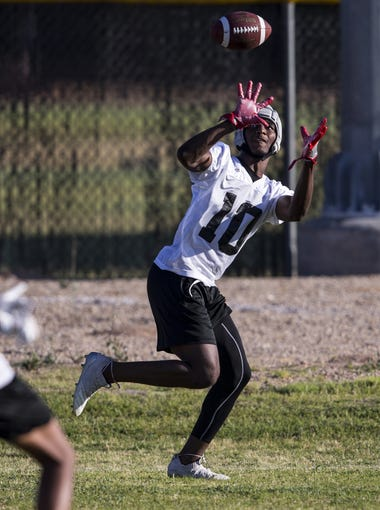 Desert Edge wide receiver Jihad Marks catches a pass during spring practice on Tuesday, May 7, 2019, at Desert Edge High School in Goodyear, Ariz.