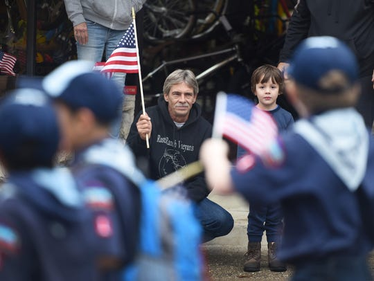 Jeff Kocsis waves a flag as he watches Clifton's Veterans
