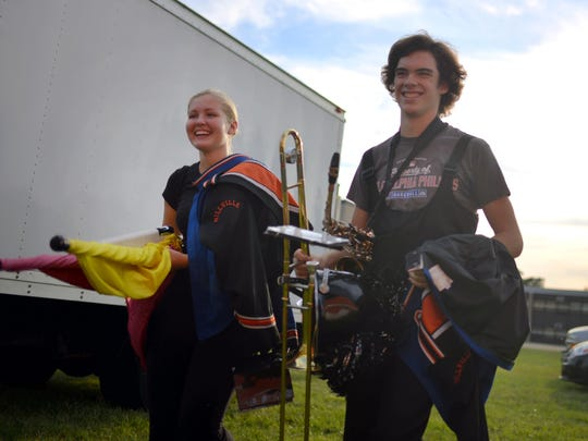 Millville band members Rileigh Panas and Theo Sherman (from left), prepare for the season opener against Egg Harbor Township, Sep. 9, 2016 in Millville.