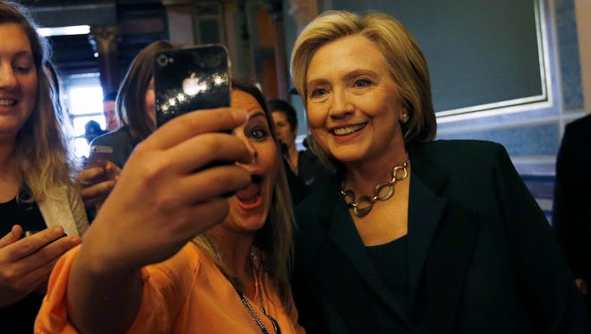 Maggie Fitzgerald takes a quick selfie with Democrat Hillary Clinton in Iowa.