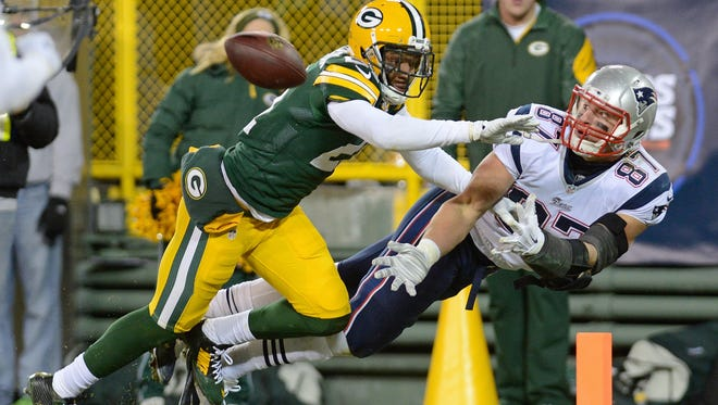 Green Bay Packers safety Ha Ha Clinton-Dix (21) defends a pass in the end zone to New England Patriots tight end Rob Gronkowski in the fourth quarter. The Green Bay Packers defeated the New England Patriots 26-21 at Lambeau Field in Green Bay, Wis. on Sunday, Nov. 30, 2014.