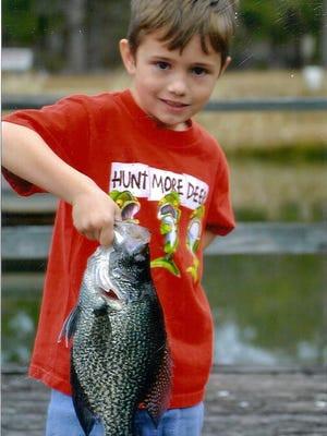 Young Bowen Brown with a crappie he caught from Lake Seminole .