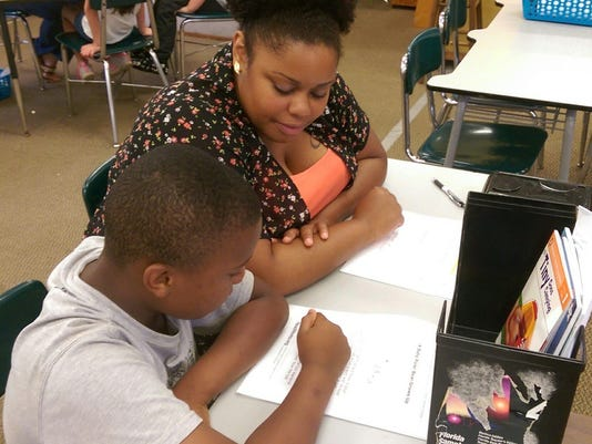Reading Mentor and Student working to improve comprehension