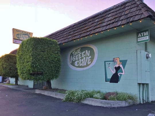 A man who pulled a gun at The Green Olive was arrested by Visalia Police Thursday night.