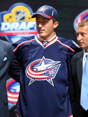 Zach Werenski poses after being selected eighth overall by the Columbus Blue Jackets in the first round of the 2015 NHL Draft. Werenski plays at the University of Michigan.