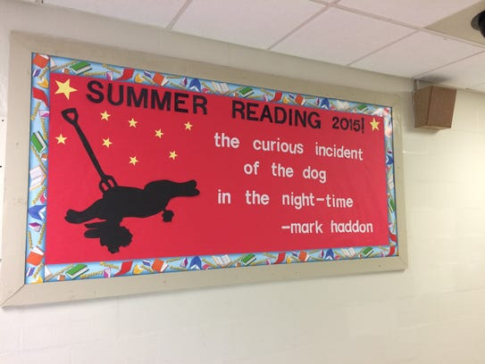 This sign promoting the summer reading assignment was