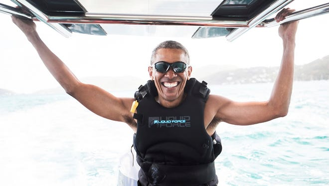 In this recent but undated photo made available by Virgin.com, former U.S President Barack Obama prepares to kitesurf during his stay on Moskito Island, British Virgin Islands. The former president and his wife stayed on Mosikto Island owned by Richard Branson, founder of the Virgin Group, after he finished his second term as President and left the White House.