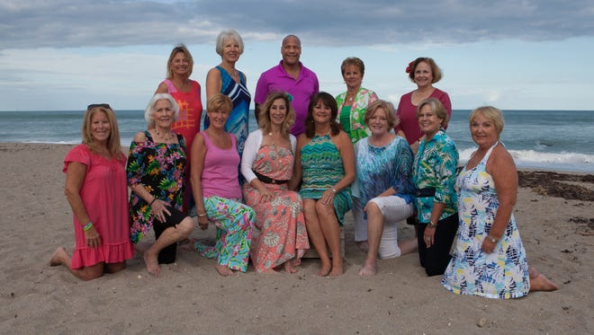 "Meet the wonderful people of the ""Return to Paradise"" committee: In front (from left) are Andi Brennan, Rita Nelson, Sharon Rodger, co-chairs Brenda Woolston and Pam Gardner, Susan Schieren, Nancy Ritter and Janine Beauchemin. Standing (from left) are Carol Holth, Joyce Powell, Daryl Magill, Judie Wolfe and Linda Schwaderer."