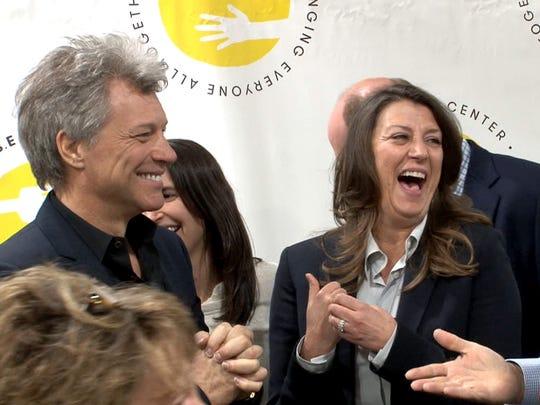 Jon Bon Jovi and his wife Dorothea Bongiovi with Carlos