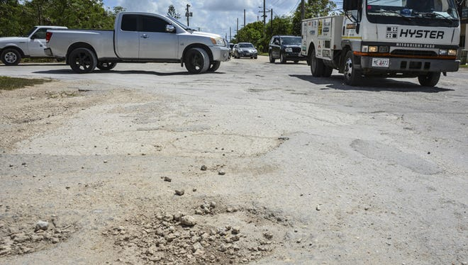 A section of damaged pavement inhibits traffic flow on Hamburger Road in Harmon on June 25.