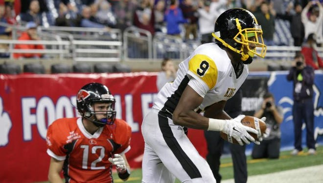Detroit King wide receiver Donnie Corley celebrates the game-winning touchdown against Lowell during the MHSAA state finals at Ford Field in November.