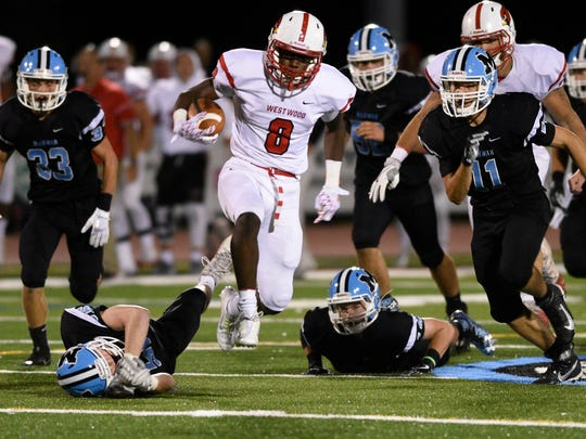 Westwood at Mahwah on Friday, September, 8, 2017. (center) W #8 Jaden Brown runs for a first down in the third quarter.