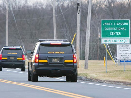 More State Troopers arrive on scene as all Delaware prisons went on lockdown late Wednesday due to a hostage situation unfolding Wednesday, Feb. 1, 2017,   at the James T. Vaughn Correctional Center in Smyrna, Del. Geoffrey Klopp, president of the Correctional Officers Association of Delaware, said he had been told by the Department of Correction commissioner that prison guards had been taken hostage.