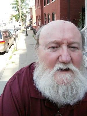 Columnist Peter J. Devlin's been insisting on his beard since 1967.