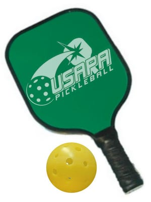Pickleball paddle and ball.