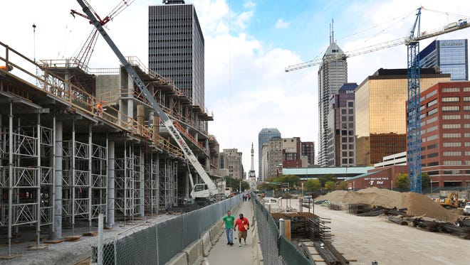 The 360 Market Square apartment tower (right) is being built next to the Cummins headquarters (left) on the site of the old Market Square Arena.
