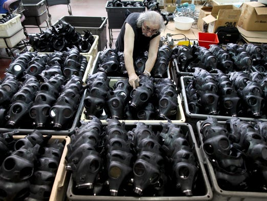 """A worker sorts masks in Kiryat Gat, Israel, the country's largest gas mask factory, on Sept. 1. According to reports, there has been a strong turnout at collection points throughout Israel for gas mask kits. Israel will respond """"with force"""" to anyone who tries to harm its citizens, Israeli Prime Minister Benjamin Netanyahu said this week after holding special security consultations on Syria."""