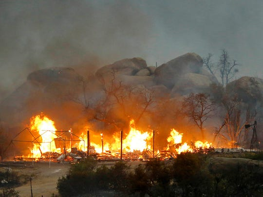 In this Sunday, June 30, 2013, file photo, the Yarnell