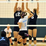 Rockledge highs #1 Alex Hollabaugh hits a shot over Mel Highs #12 Shelby Alsdorf and teammate #5Hannah Wilkins during Wednesday night match held at Melbourne High gym. CRAIG RUBADOUX FLORIDA TODAY